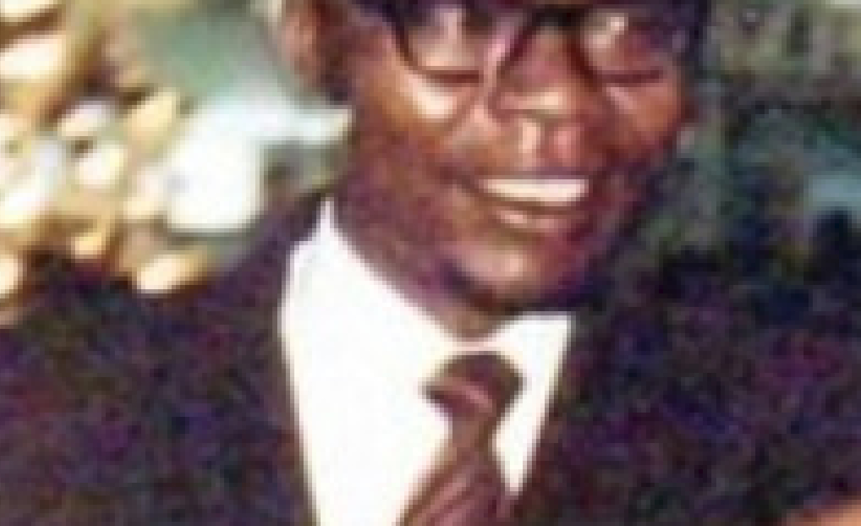 In this image of Barack Obama Sr. with young Obama light from the background bleeds into Barack Obama Sr.'s neck just below his right ear. (CLICK TO ENLARGE)