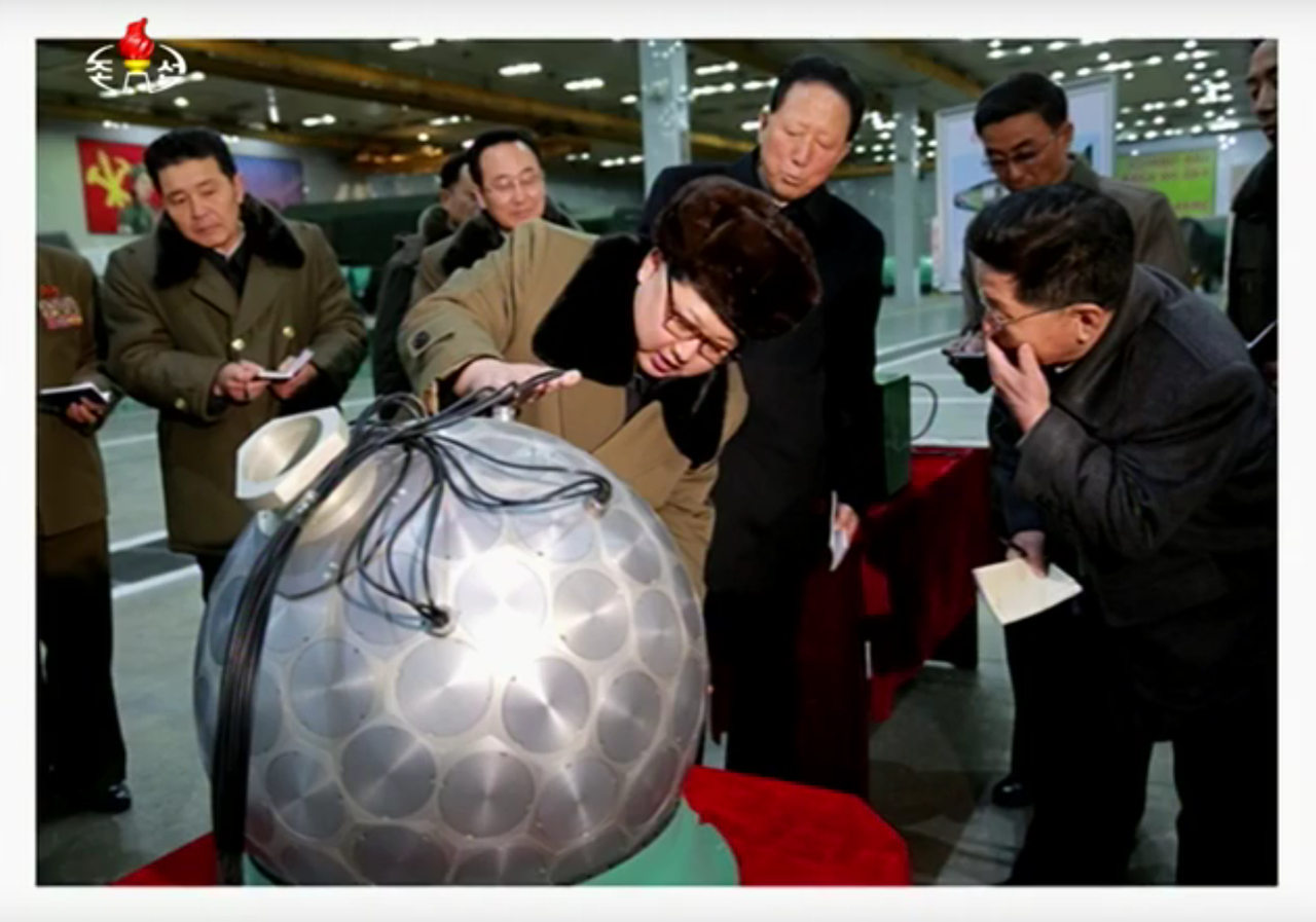 North Korean leader Kim Jong-un showing off an apparent miniaturized nuclear weapon during a 2016 Korean Central Television broadcast.