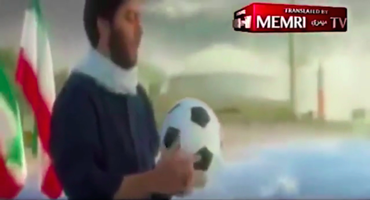 Iranian propaganda video: A man holding a soccer ball on the beach after depiction of the Iran Air Flight 655 accidental shootdown and the depiction of the sinking of an entire US Navy Fleet, including the USS Vincennes. A nuclear reactor along the beach can be seen in the background.